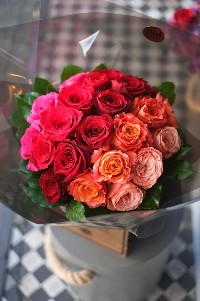 A Flower bouquet in London that is a wave of colour, 5 types of large headed roses combined to give a sophisticated look.