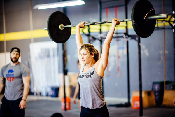 Jumpbox Fitness WOD apparel - crossfit weightlifting athlete photo - overhead press - amraptor womens tank