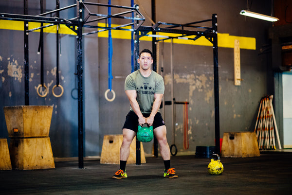 Jumpbox Fitness WOD apparel - crossfit kettlebell athlete photo - kettlebell swing- kettlebellion men's tshirt