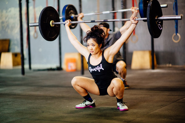 Jumpbox Fitness WOD apparel - crossfit weighlifting athlete photo - snatch squat - powerful tank