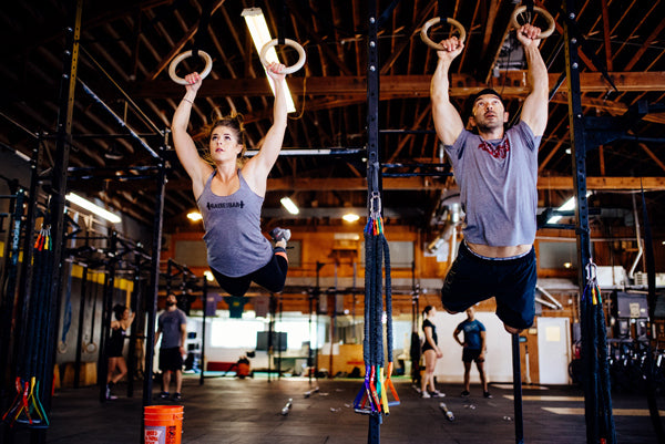 Jumpbox Fitness apparel - crossfit athletes photo - muscle up-s