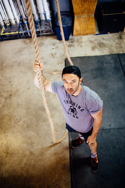 Jumpbox Fitness WOD apparel - crossfit rope climb athlete photo - training club t-shirt