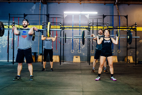 Jumpbox Fitness WOD apparel - crossfit weightlifting athletes photo - cleans