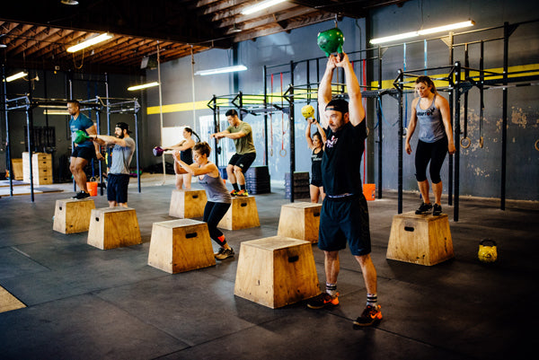 Jumpbox Fitness WOD apparel - crossfit kettlebell athlete photo - box jumps