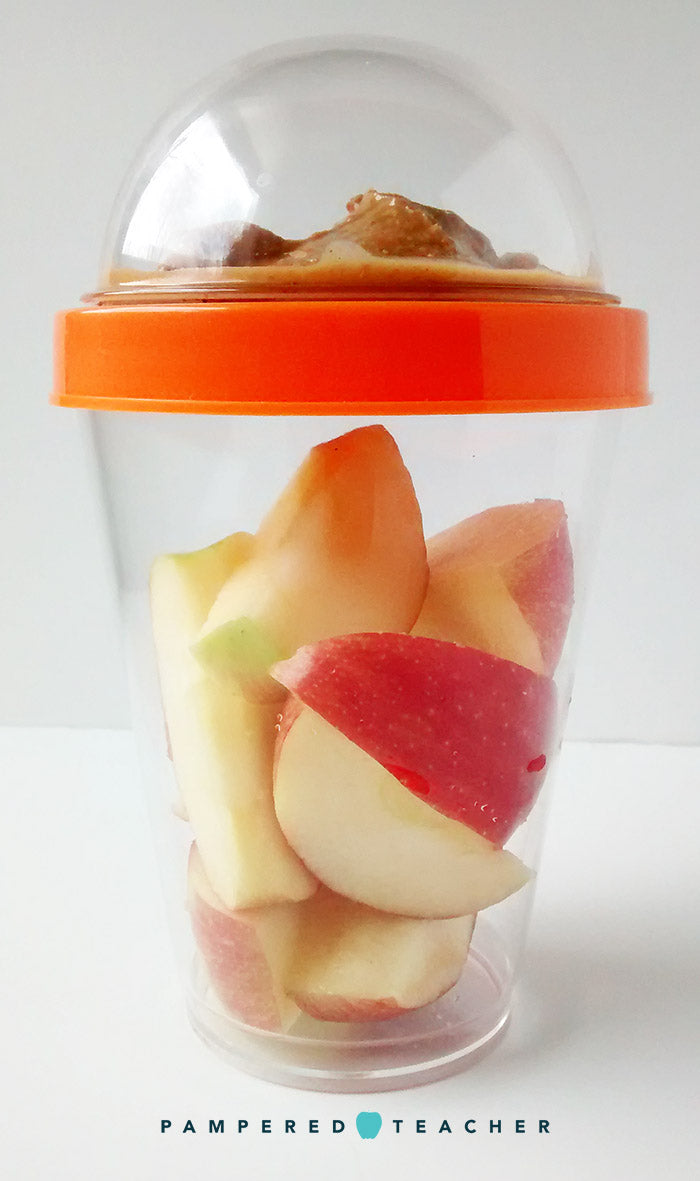 Pack apples and peanut butter as a healthy snack on the go in a reusable yogurt parfait cup