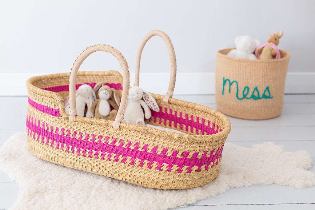 Pink woven moses basket
