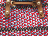 DHAHABU: Handwoven Blue and Red Wool Bucket Bag