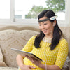 Macrotellect BrainLink Lite EEG Headband on a woman with iPad