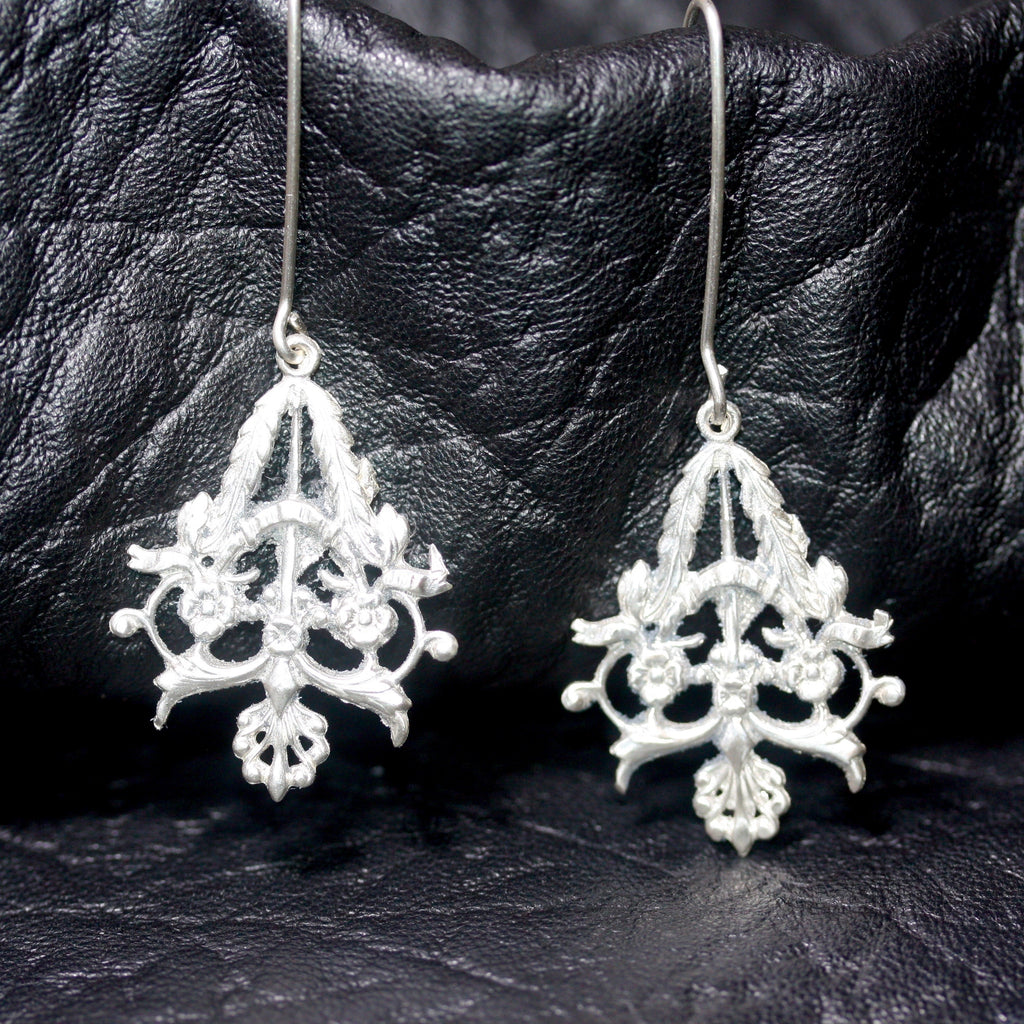 Ornate resurgence earrings -  Sale