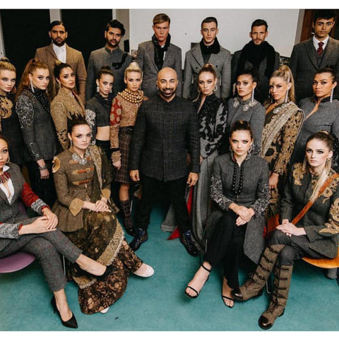 Designer Hassan Sheheryar Yasin surrounded by models at the Medical Aid to Pakistan Fashion Show