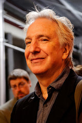 A photo of Alan Rickman smiling