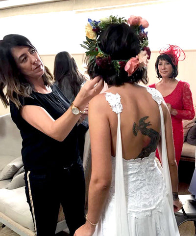 Hair Stylist and Makeup Artist Jenn Mathieson adjusting a brides hair