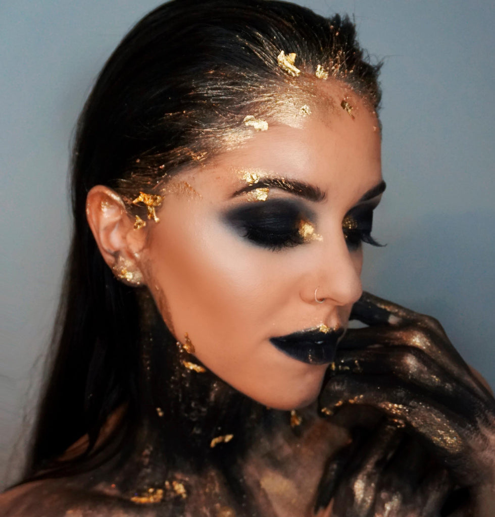 Black and gold makeup look created by Academy of Makeup Graduate Dafne Martines