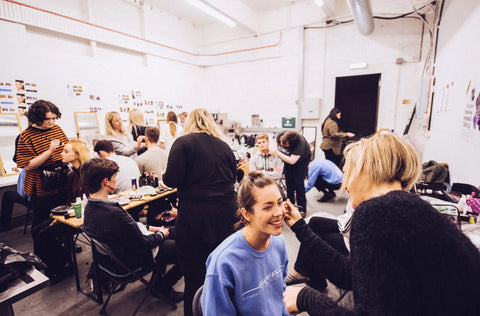 Photo of Academy of Makeup Students working backstage at GUCFS by Carlo Paloni
