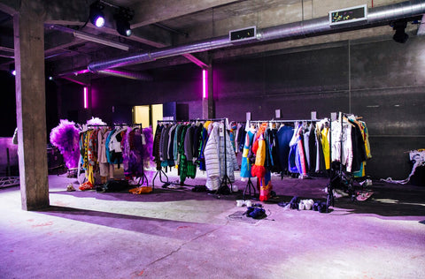 Clothes Rail Back Stage at GUCFS Fashion Show Photo by Carlo Paloni