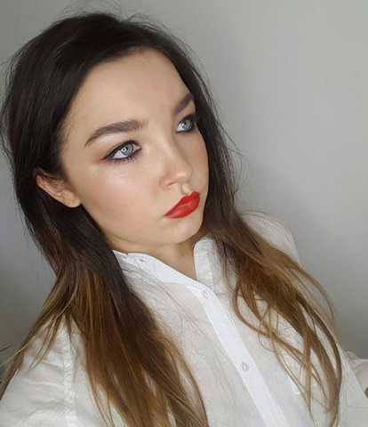 Makeup look with a gorgeous eyeliner flick and a bold red lip