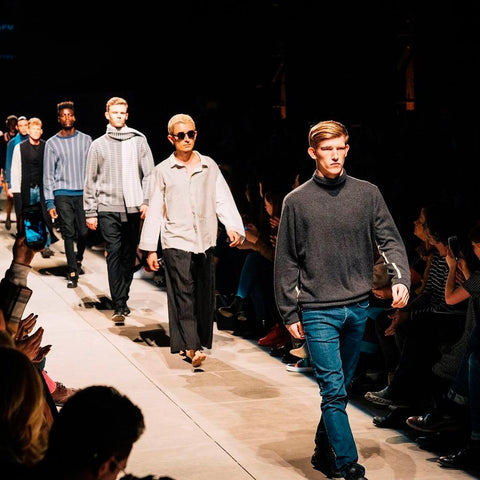 male models walking down the runway at a fashion show