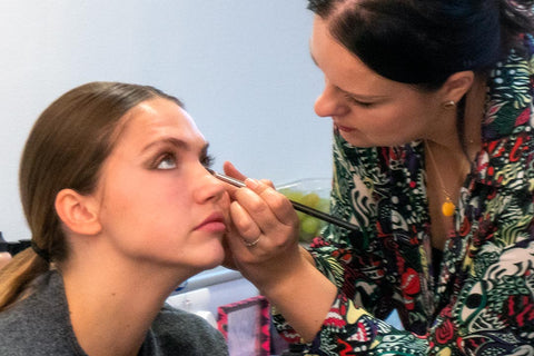 TAOM Graduate Gosia applying makeup backstage
