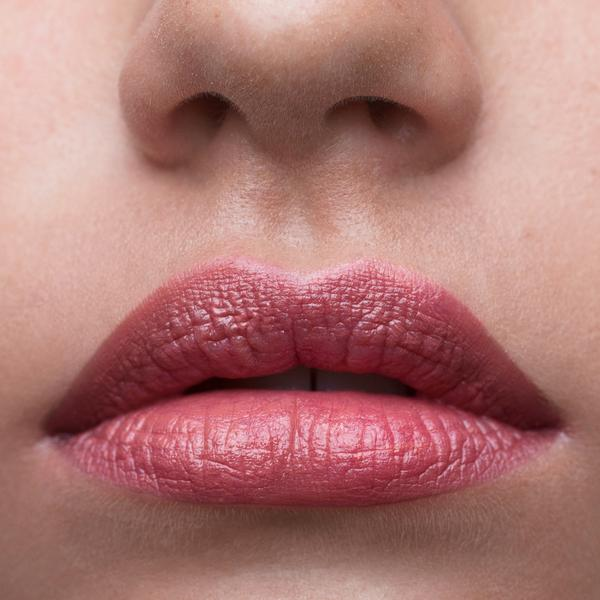 Close up of lips wearing I-AM lipstick