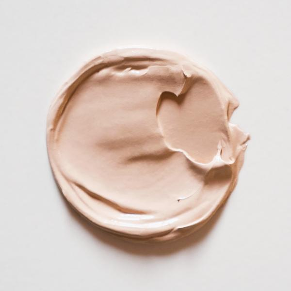 A circular swatch of Little Pop Concealer in Milk Bottle Shade