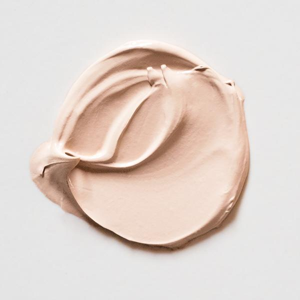 A circular swatch of Little Pop Concealer in Peely Wally Shade