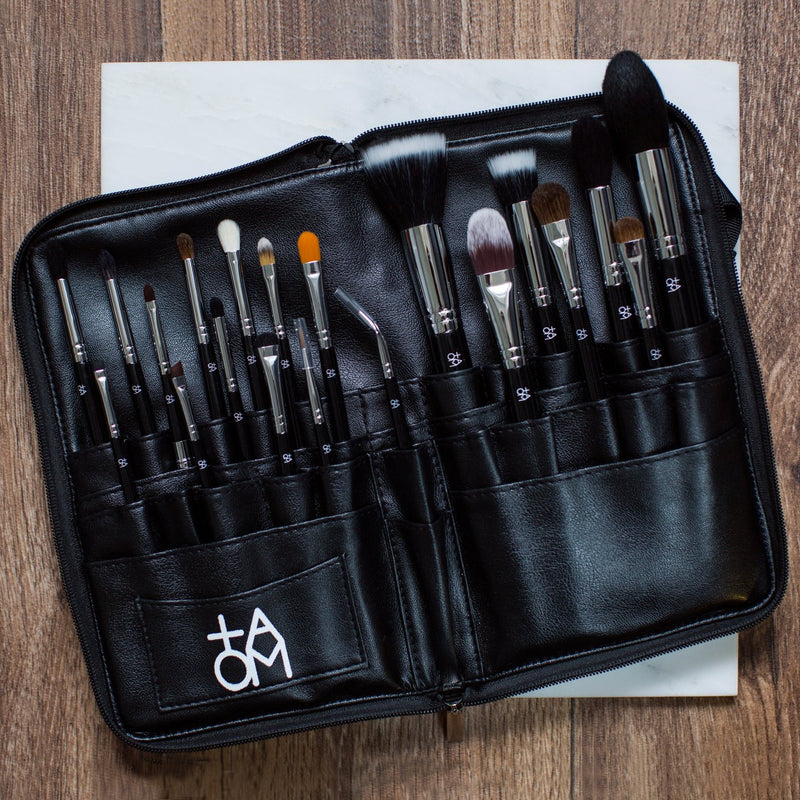 20 Piece TAOM brush set against a wooden background