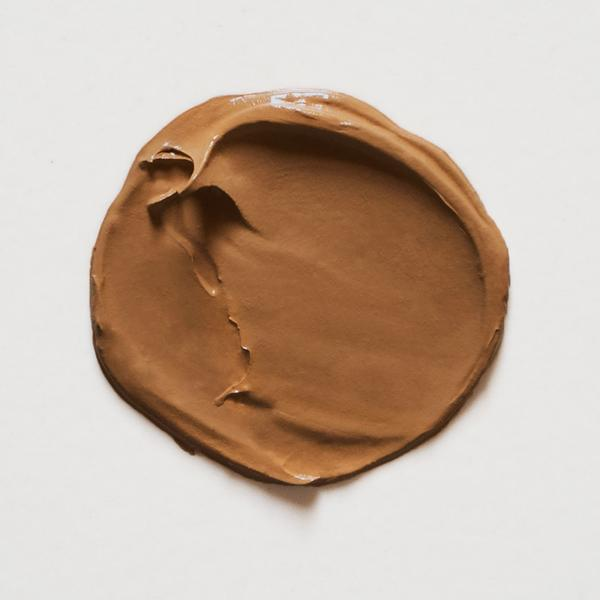 A circular swatch of Little Pop Concealer in Toffee Shade
