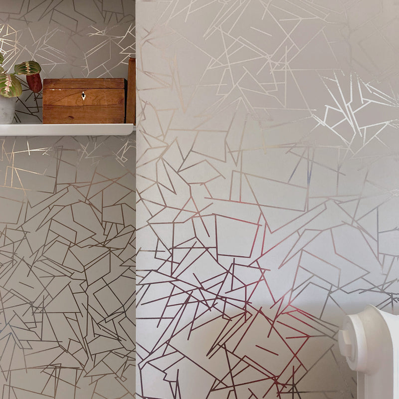 Angles pewter / limestone wallpaper by Erica Wakerly