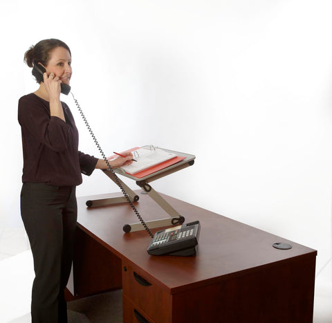 woman on phone using t-zone standing desk