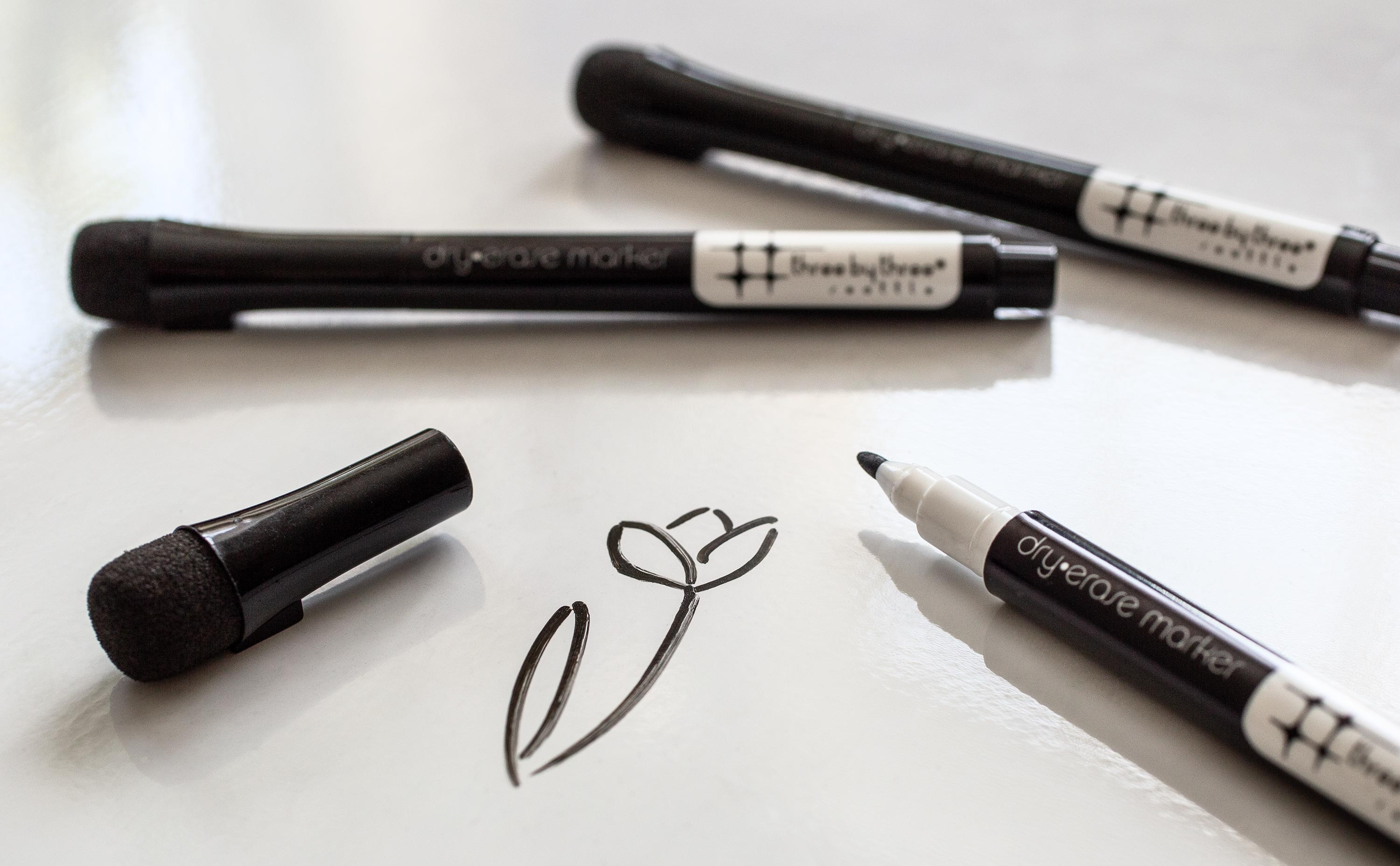 black whiteboard markers with flower doodle