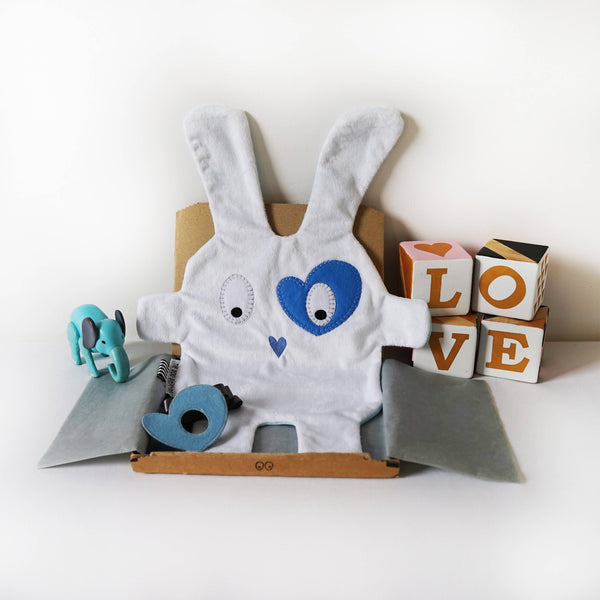 White & blue heart style comforter by The Dou-Doods in postage box with blue heart shaped kids dress up eye patch