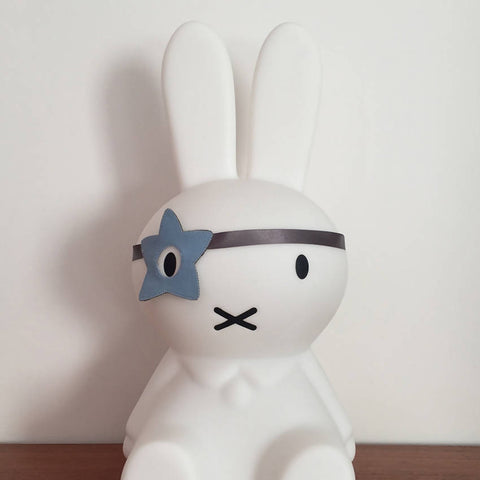 Blue felt star style dress up eye patch on a Miffy bunny