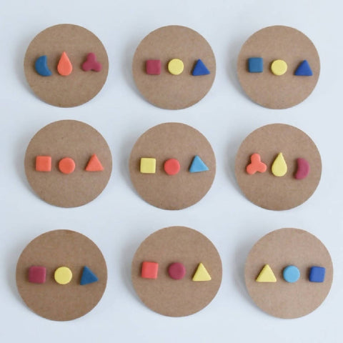 Trio of porcelain stud earrings