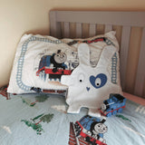 White & blue heart style comforter by The Dou-Doods on toddler bed