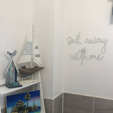 Sail away with me, wall mounted wire words. Three dimensional typography.