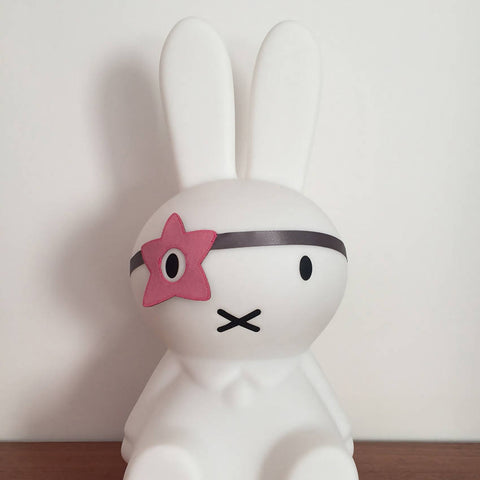Pink felt star style dress up eye patch on a Miffy bunny