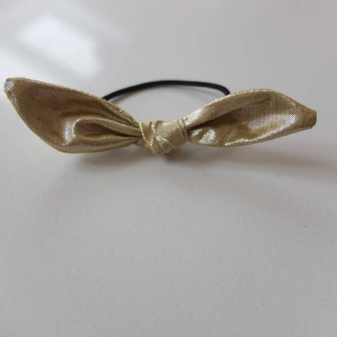 Gold hair bow. Elastic tie.