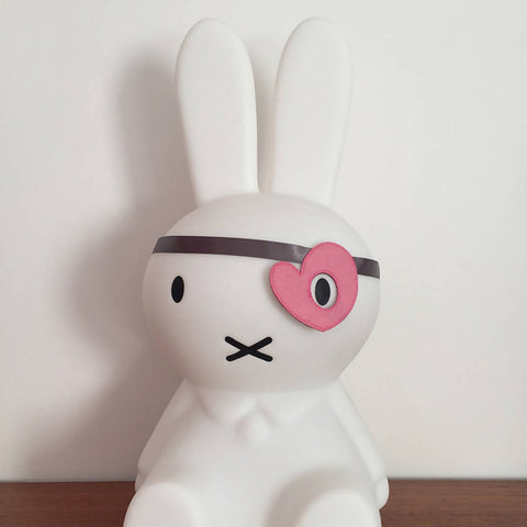 Pink felt heart style dress up eye patch on a Miffy bunny