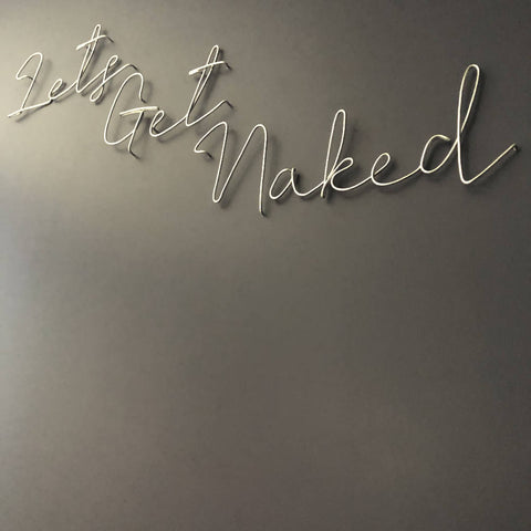 Let's Get Naked, wall mounted wire words. Three dimensional typography.