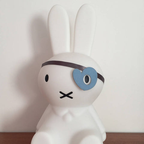 Blue felt heart style dress up eye patch on a Miffy bunny
