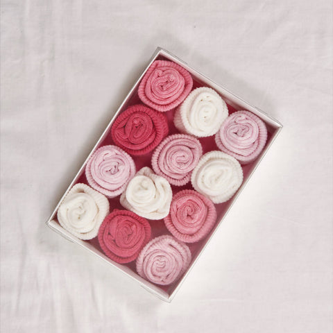 A beautiful box of 'rose' pink and cream socks, size 0-6 months