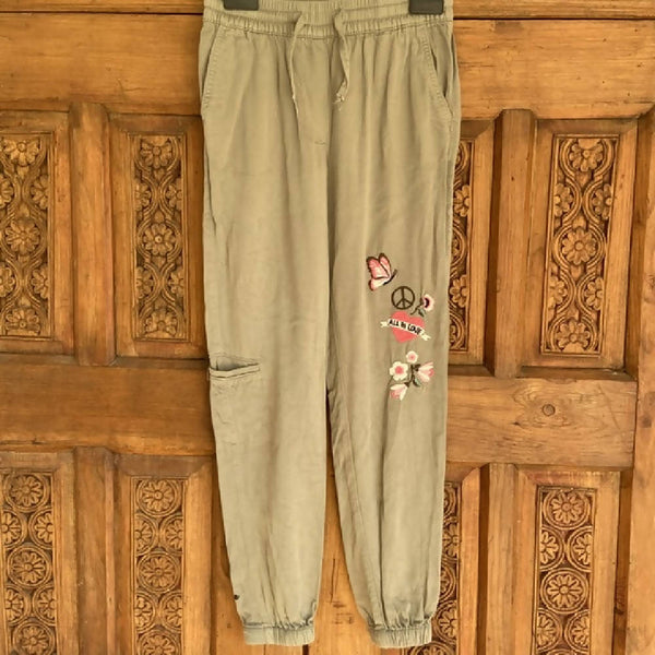 H&M girls green relaxed trousers, age 8-9