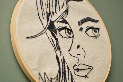 Monochrome embroidered pop art face hoop - Wall Art