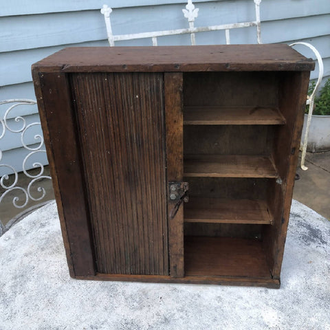 Vintage wooden cupboard with tambour roller door