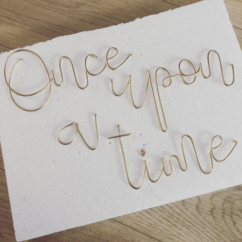 Once upon a time, (freehand) wall mounted wire words. Three dimensional typography.