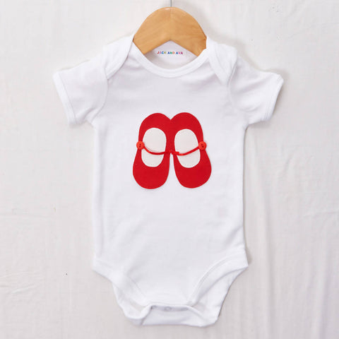 Red and white ballet shoes on a White baby grow, size 0-3 months