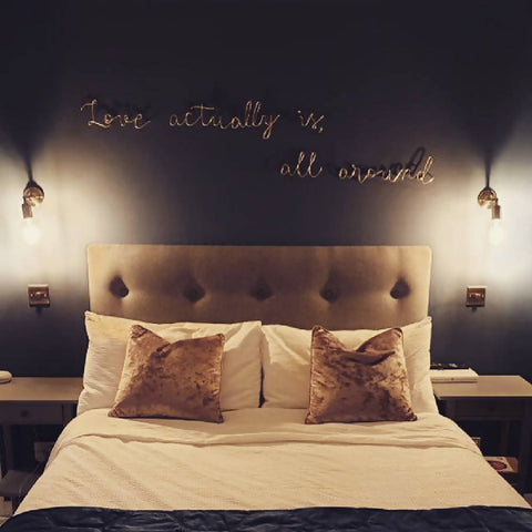 Love actually, is all around, wall mounted wire words. Three dimensional typography.