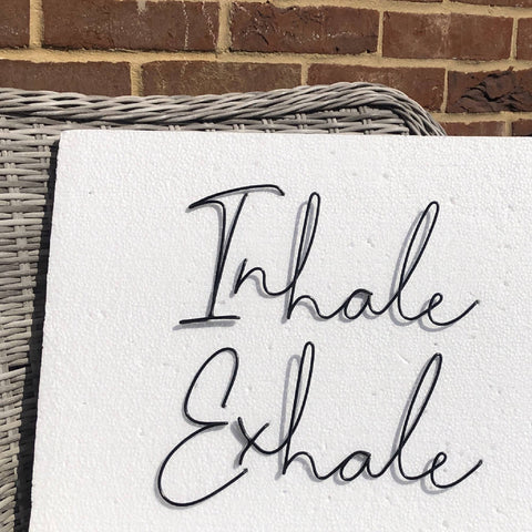 Inhale Exhale, wall mounted wire words. Three dimensional typography.