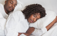 Couple sleeping better on Adjustable Loft Bed Pillows from A Little Pillow Company.  Made in Virginia since 2007.