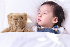 Little boy sleeping on A Little Pillow Company Baby Starter Pillows 10x16 for ages 18 - 24 months